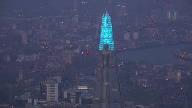 aerial shots of buildings in london illuminated in blue for the national applause to honour nhs and key workers during the coronavirus outbreak on 9... - nhs stock videos & royalty-free footage