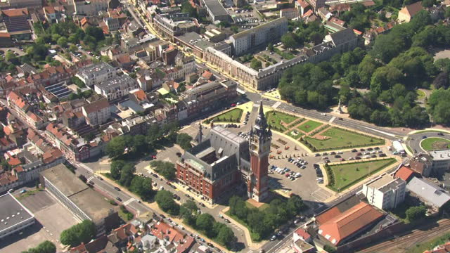aerial shots of calais including the hotel de ville and eglise notredame >> on july 29 2015 in calais france - calais stock videos and b-roll footage