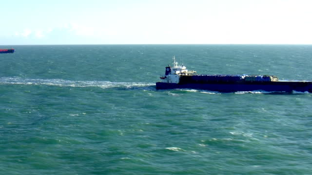 aerial shots of cargo ships at sea on the english channel on january 19, 2018 at sea near england. - english channel stock videos & royalty-free footage