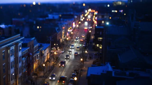 aerial shots of cars driving down a street at night with lamposts light up along the sidewalks in albany new york - albany new york state stock videos & royalty-free footage