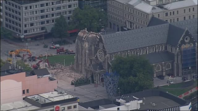 Aerial shots of central city the day after earthquake with smoking destroyed CTV building Christ Church Cathedral and Cathedral of the Blessed...