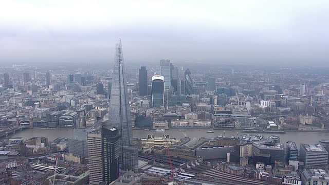 aerial shots of central london on a cloudy overcast winter day flying towards the city of london with views of the shard 20 fenchurch street and 30... - overcast stock videos & royalty-free footage