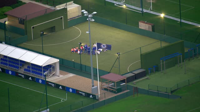 aerial shots of chelsea fc training grounds with people training on a pitch on december 17 2015 in cobham england - cobham training ground stock videos and b-roll footage