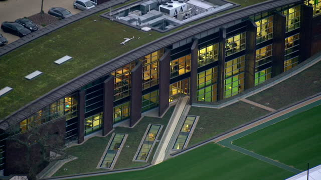 aerial shots of chelsea fc training grounds zoom in to building with green roof swimming pool gym facilities visible on december 17 2015 in cobham... - cobham training ground stock videos and b-roll footage
