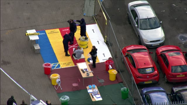 Aerial shots of Churchfields Industrial Estate with police officers and emergency services at the scene including shots of forensics officers taking...