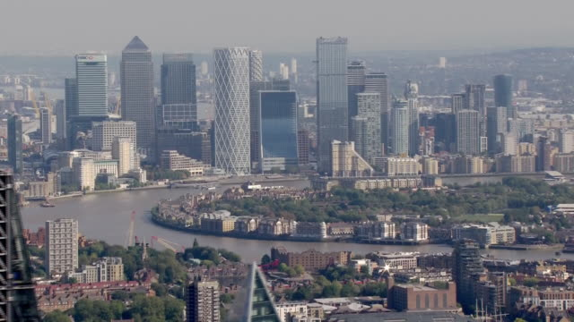 aerial shots of city of london and financial district skyscrapers including canary wharf, swiss re building on either side of the thames on 21... - financial district stock videos & royalty-free footage