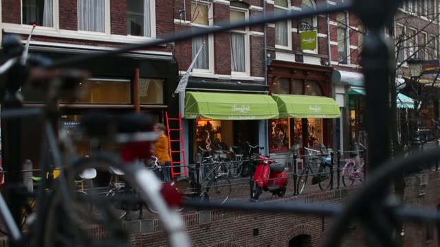aerial shots of clothing fashion retailers and a cafe sitting along a canal in utrecht netherlands dutch retail utrecht netherlands on november 28... - utrecht stock videos & royalty-free footage