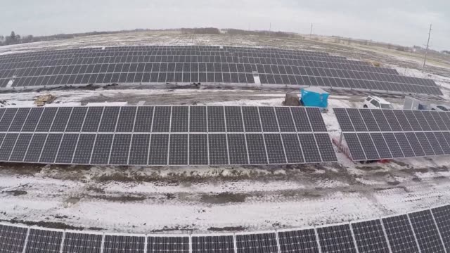 Aerial shots of contractors with Dragonfly Solar working during construction of a solar array for Heartland Power Cooperative in St Ansgar Iowa...