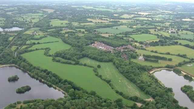 aerial shots of countryside, farmland and small town suburbs on 8 june 2020 in kent, united kingdom - kent england bildbanksvideor och videomaterial från bakom kulisserna
