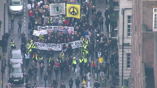 Aerial shots of crowds of protesters marching from the US Embassy in London during a demonstration against the socalled 'Muslim ban' travel...