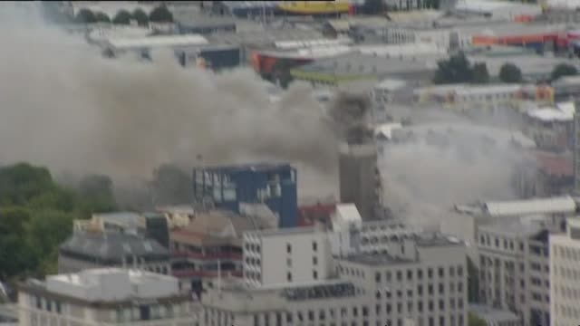 aerial shots of damage in city with smoking canterbury television building marquees and liquefaction in hagley park and cathedral of the blessed... - jordbävning bildbanksvideor och videomaterial från bakom kulisserna