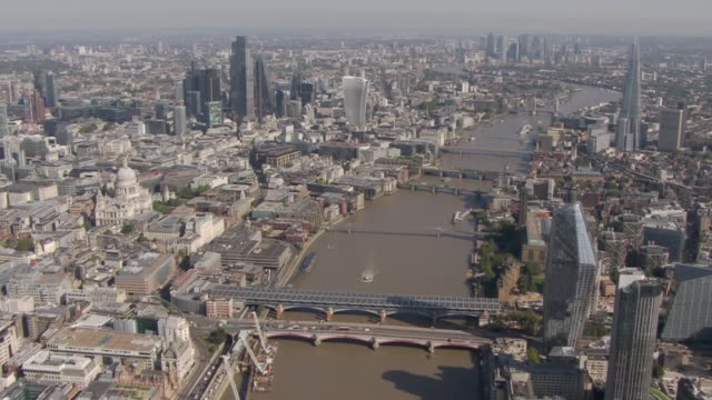 aerial shots of downing street and along the river thames to the city of london, with skyscrapers including the walkie talkie and the shard on 21... - building exterior stock videos & royalty-free footage