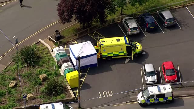 aerial shots of emergency crews at the scene of jo cox mp murder a police tent ambulance on june 16 2016 in leeds england - jo cox politician stock videos and b-roll footage