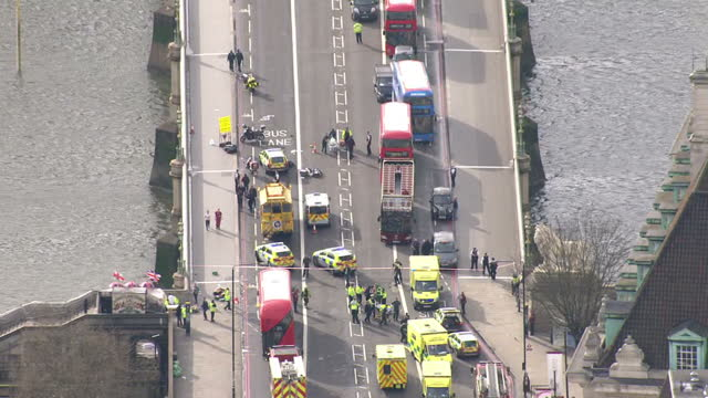 aerial shots of emergency services on westminster bridge and outside the houses of parliament in the aftermath of the terror attack in westminster on... - westminster bridge stock videos & royalty-free footage
