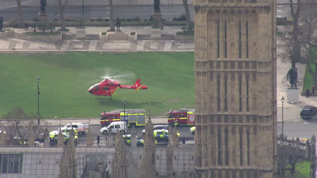 aerial shots of emergency services on westminster bridge and outside the houses of parliament in the aftermath of the terror attack in westminster,... - westminster bridge stock videos & royalty-free footage