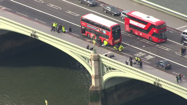 aerial shots of emergency services on westminster bridge in the aftermath of a terrorist attack in which a vehicle drove into pedestrians on the... - emergency services vehicle stock videos and b-roll footage