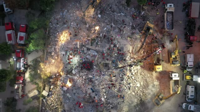 aerial shots of emergency services personnel searching a collapsed building for survivors after a powerful earthquake struck on october 31, 2020 in... - kara sea stock videos & royalty-free footage