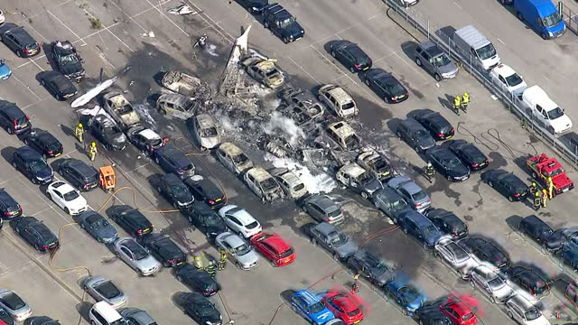 vídeos de stock e filmes b-roll de aerial shots of emergency services putting out fire from a plane crash at blackbushe airport, that killed members of the bin laden family on august... - hampshire