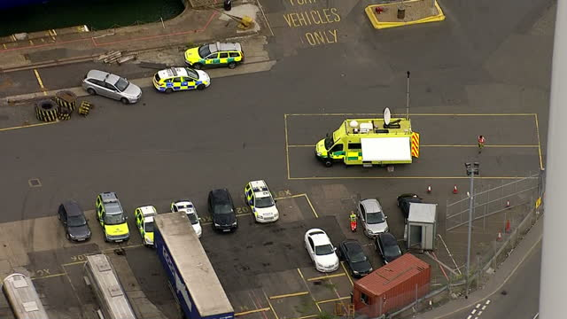 aerial shots of emergency services vehicles at tilbury docks, where a group of immigrants were discovered inside a shipping container.>> on august... - film container stock videos & royalty-free footage