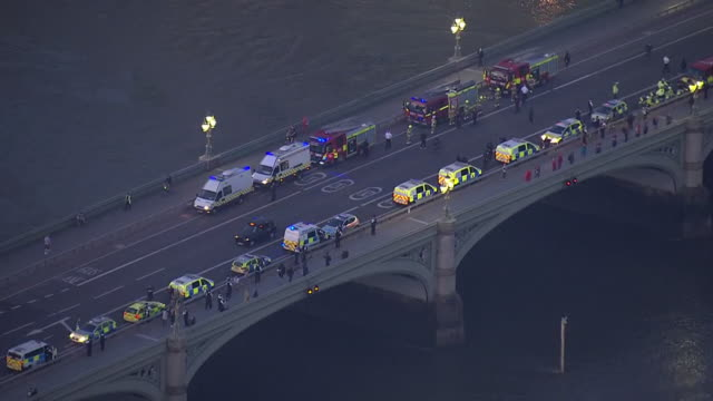 aerial shots of emergency services with blue lights flashing and boats on river thames join in for the national round of applause to honour key... - westminster bridge stock-videos und b-roll-filmmaterial