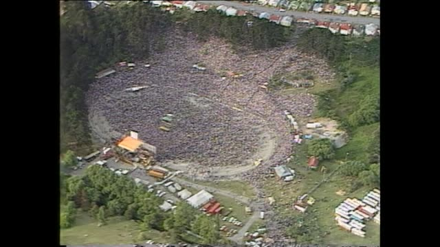 stockvideo's en b-roll-footage met aerial shots of estimated crowd of 80000 prior to 1983 david bowie concert at western springs stadium in auckland - david bowie