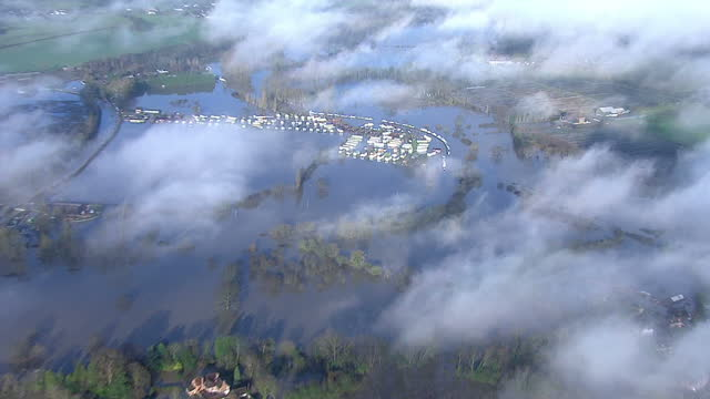 stockvideo's en b-roll-footage met aerial shots of extensive flooding in yaldingkent including a flooded caravan park with static caravans partly washed off their footings and a line... - goede staat