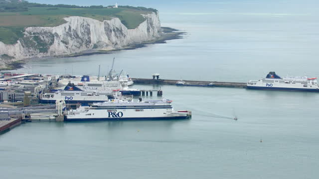 aerial shots of ferries docked at the port of dover and parked lorries and trailers on the dockside>> on june 23 2015 in calais france - calais stock videos and b-roll footage
