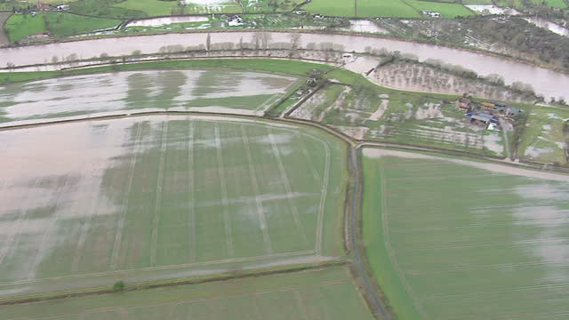 aerial shots of flooded farmland along the river severn aerial shots of flooding along the river severn on january 03 2014 - river severn stock videos & royalty-free footage