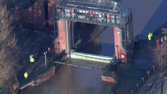 aerial shots of flooding along the river ouse in york and the foss barrier with the floodgate closed after being repaired.>> on december 29, 2015 in... - river ouse stock videos & royalty-free footage