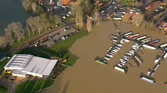 aerial shots of flooding of the billing aquadrome leisure park and holiday homes surrounded by flood water on 25th december 2020 in great billing,... - northampton england stock videos & royalty-free footage