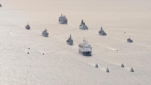 aerial shots of flotilla of naval vessels follows dday veterans on board the royal british legion's ship mv boudicca traveling to normandy to... - flotilla stock videos & royalty-free footage