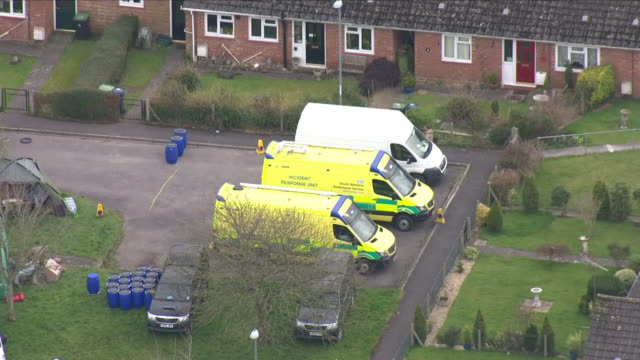 aerial shots of forensics officers and military officers wearing protective clothing at the scene in gillingham with emergency vehicles including... - イングランド ケント点の映像素材/bロール
