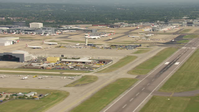 aerial shots of gatwick airport tarmac, runway and stationary planes air side on september 13, 2016 in england. - gatwick airport stock videos & royalty-free footage