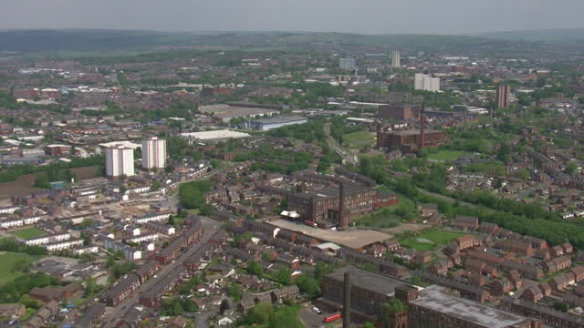 aerial shots of hartford mill building historically used for cotton milling on may 19 2014 in oldham greater manchester england - mill stock videos & royalty-free footage
