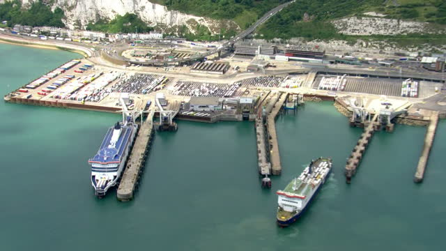 Aerial shots of he port showing moored ferries and a busy terminal area full of cars and lorries queueing for the Euro Tunnel on July 25 2015 in...