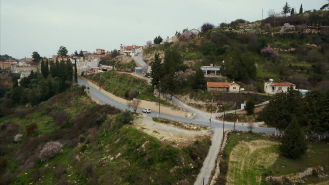 stockvideo's en b-roll-footage met aerial shots of hillside houses and roads in southern cyprus - repubiek cyprus