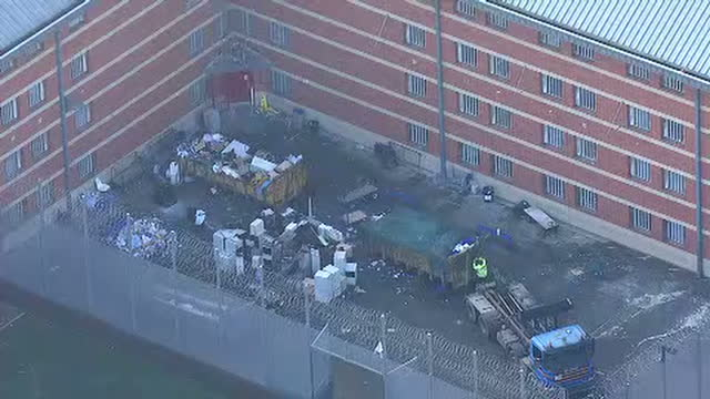 stockvideo's en b-roll-footage met aerial shots of hm prison birmingham in the aftermath of prison riots with rubbish being cleared up in courtyards on december 21 2016 in birmingham... - west midlands