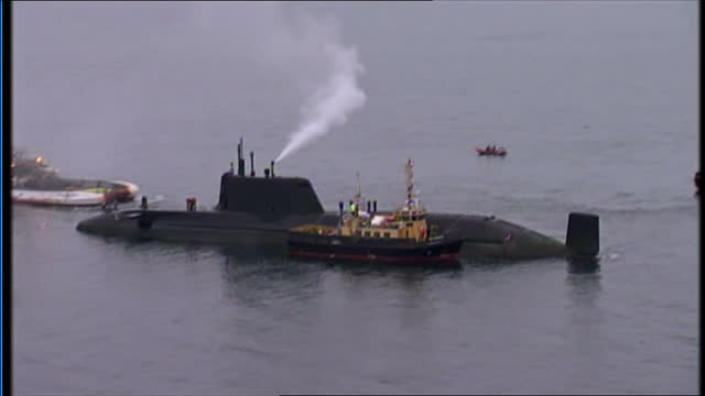 aerial shots of hms astute submarine at sea with rescue ships nearby rescuers have spent today trying to get one of britain's most advanced nuclear... - skye stock videos and b-roll footage