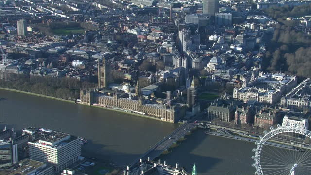 aerial shots of houses of parliament, westminster bridge and the river thames on clear sunny day following brexit deal announcment on 24 december... - house of commons stock videos & royalty-free footage