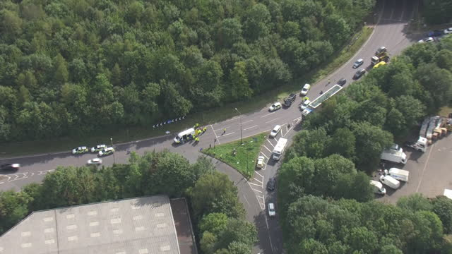 aerial shots of insulate britain climate activists blocking a slip road from the m25, causing a long tailback on the motorway, the group calls for... - insulator stock videos & royalty-free footage