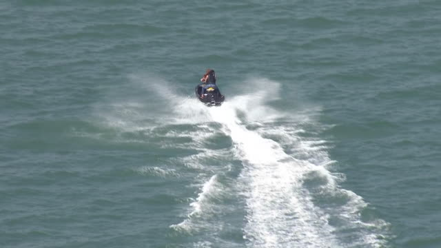 aerial shots of jet skiers and sailing dinghies at sea off southend beach on 25 may 2020 in southend on sea united kingdom - skiing stock videos & royalty-free footage