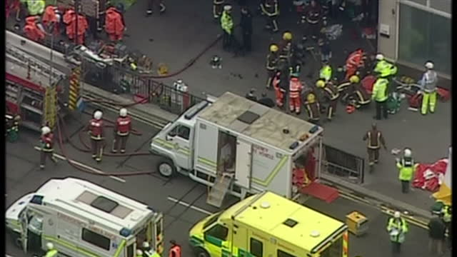 aerial shots of july 7th al qaeda bombings aftermath at aldgate tube station injured people are carried on stretchers into ambulances emergency teams... - 2005 stock videos and b-roll footage