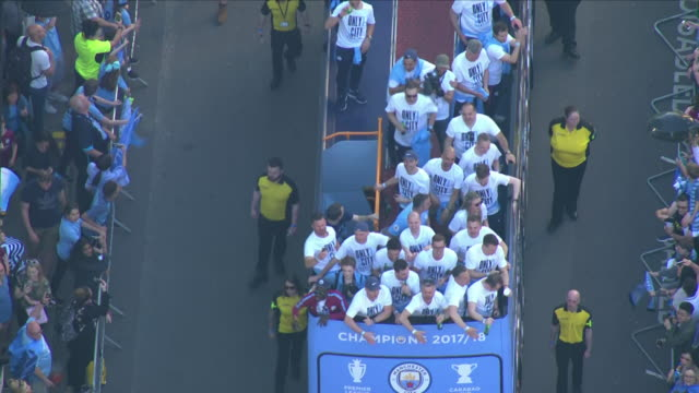 aerial shots of manchester city football players celebrating premiere league win in an opentop bus on 14 may 2018 in manchester united kingdom - sports league stock videos & royalty-free footage