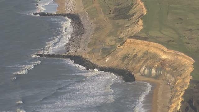 vídeos de stock e filmes b-roll de aerial shots of milford on sea coastline & sea defences on february 21, 2014 in hampshire, england. - hampshire