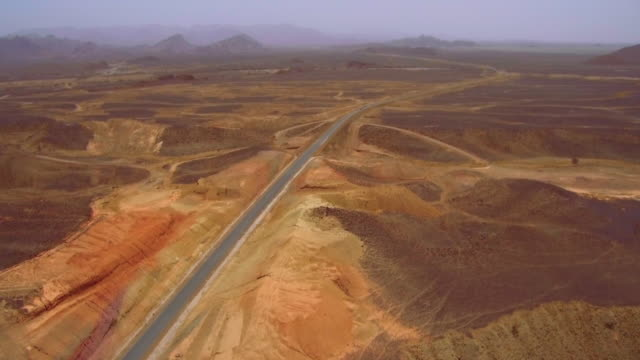 aerial shots of new road infrastructure in ethiopia - braun stock-videos und b-roll-filmmaterial