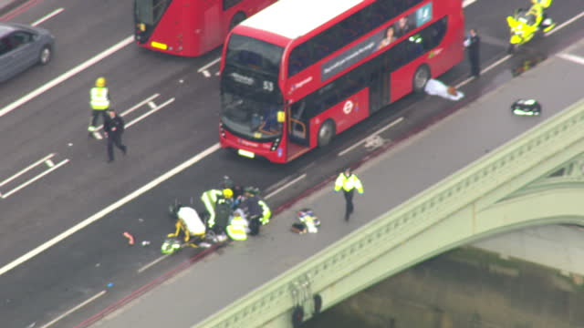 aerial shots of paramedics tending to casualties on westminster bridge in the aftermath of a terror attack on westminster on march 22 2017 in london... - westminster bridge stock-videos und b-roll-filmmaterial
