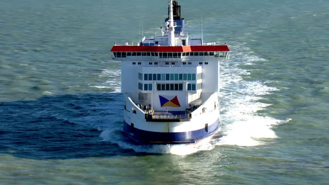 aerial shots of passenger ferries on the english channel with views of a po ferry approaching dover a dfds ferry sailing out into the channel and... - cargo ship stock videos & royalty-free footage