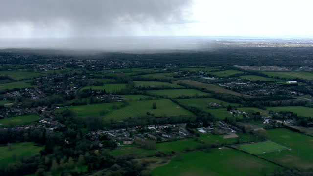 Aerial shots of patches of cloud and sunshine over the outskirts of SouthEast London and looking towards clearer weather around the O2 Arena>> on...