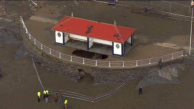 aerial shots of people looking at damage debris along the aberystwyth seafront following a tidal surge tidal surge damage in aberystwyth on january... - aberystwyth stock videos & royalty-free footage