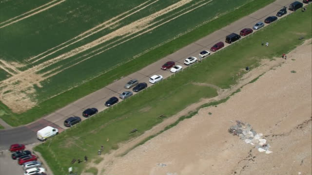 aerial shots of people on worthing and goring beaches and a line of cars parked as coronavirus lockdown measures are eased on 15 may 2020 in... - worthing点の映像素材/bロール